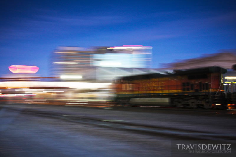 A BNSF train flashes past the Kansas City Union Station.