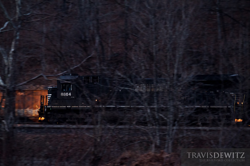 "Norfolk Southern 8864 moves a string of filled coal hoppers from the Teco Mine just west of Hurley, Virginia as darkness has long ago started to set in on the hollar.  Travis Dewitz <a href=""http://www.therailroadcollection.com/latest-works/"" target=""_blank"">The Railroad Collection</a>"