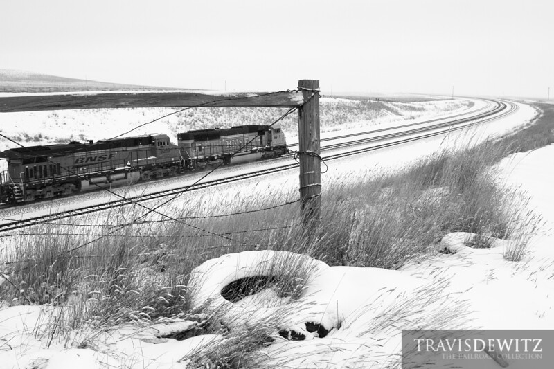 More coal flies along the snow covered landscape powered by BNSF.