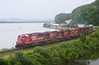 "A Soo Line SD60 leads a string of red Canadian Pacific GEs up the Mississippi River at Maple Springs, Minnesota.  Travis Dewitz <a href=""http://www.therailroadcollection.com/latest-works/"" target=""_blank"">The Railroad Collection</a>"