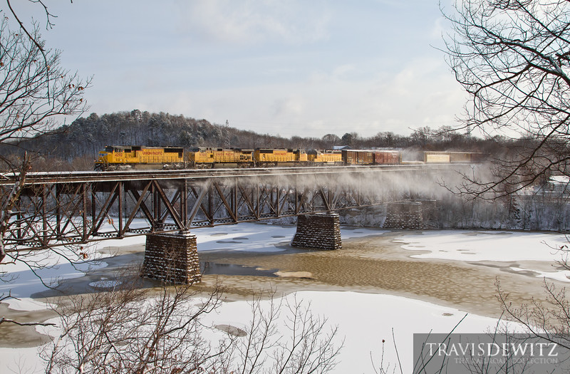 """Fresh snow flies off MPRSS and the trestle over the Chippewa River as Union Pacific 4292 rushes it's train west out of Eau Claire, WI toward South Saint Paul.  Travis Dewitz <a href=""""http://www.therailroadcollection.com/latest-works/"""" target=""""_blank"""">The Railroad Collection</a>"""