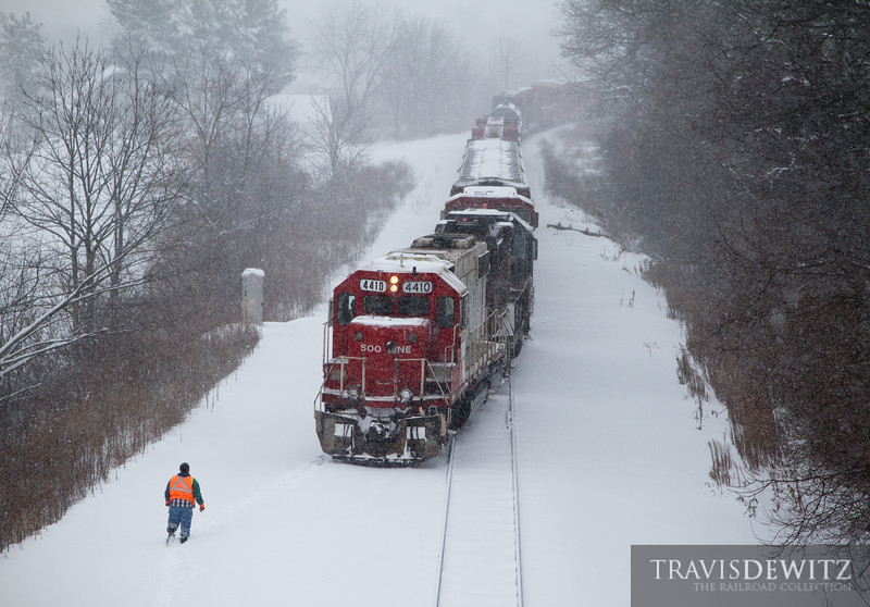 """Heavy snowfall from a winter storm has caused more work for the crew of Soo 4410 as the switch into Wabasha yard needs to be cleared before the local can be taken off the main.  Travis Dewitz <a href=""""http://www.therailroadcollection.com/latest-works/"""" target=""""_blank"""">The Railroad Collection</a>"""