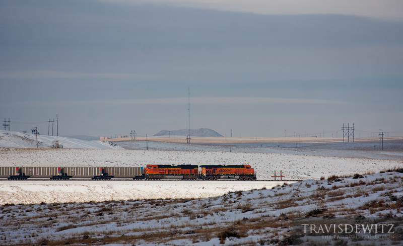 """Empty BNSF coal train heads north up the Orin Sun on a cold January day.  Travis Dewitz <a href=""""http://www.therailroadcollection.com/latest-works/"""" target=""""_blank"""">The Railroad Collection</a>"""