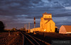 The setting sun paints the Berea grain elevator a vibrant orange to end the day in North Dakota.