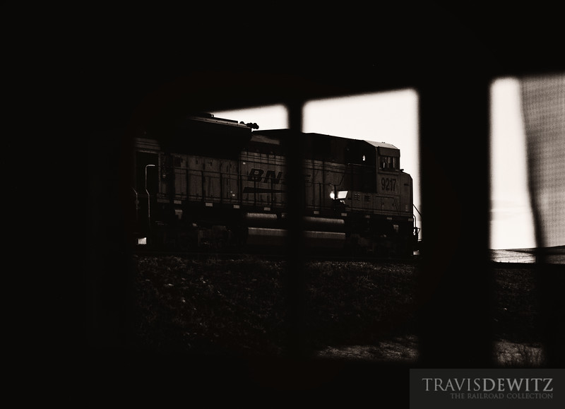 "Night is starting to fall as I peer out a broken window at a coal train from inside an old abandoned house out on the Wyoming plains.  Travis Dewitz <a href=""http://www.therailroadcollection.com/latest-works/"" target=""_blank"">The Railroad Collection</a>"
