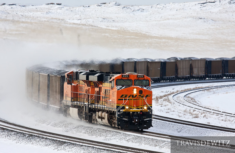 """BNSF 6123 kicks up fresh powder as it flies north with a loaded coal train near the Codero Mine.  Travis Dewitz <a href=""""http://www.therailroadcollection.com/latest-works/"""" target=""""_blank"""">The Railroad Collection</a>"""