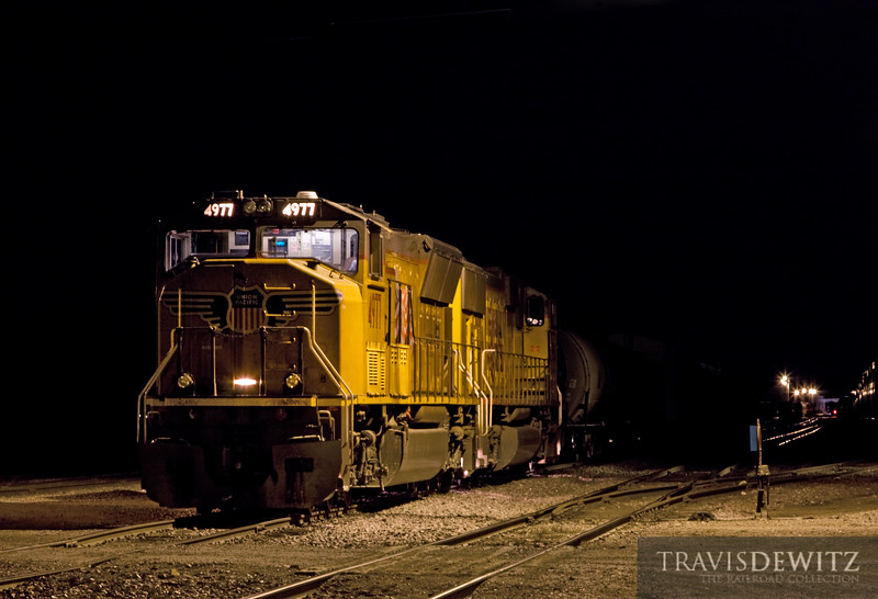 """The lights of the Altoona yard eerily light a set of locomotives from the very dark night that covers the rest of the yard. The EOT can be seen at the other end of the yard from a departing train.  Travis Dewitz <a href=""""http://www.therailroadcollection.com/latest-works/"""" target=""""_blank"""">The Railroad Collection</a>"""
