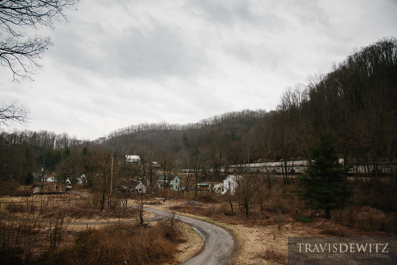 Such a common sight to see strings of Norfolk Southern Top Gon coal hoppers moving past small West Virginia towns like can be seen here in Switchback.