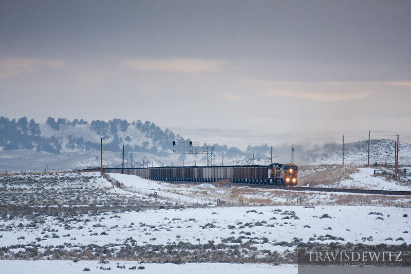 Ex-Chicago and Northwestern AC44CW takes its loaded coal train across its old rails just west of Shawnee, Wyoming.