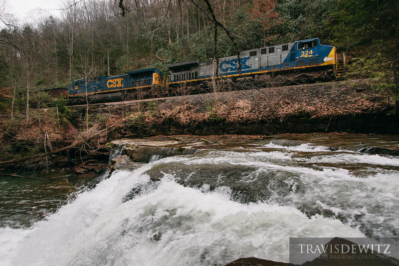 RJ Corman crewed coal train with CSX power works up grade over the Loup Creek waterfall.