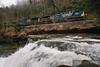 RJ Corman crewed coal train with CSX power works up grade over the Loup Creek waterfall.