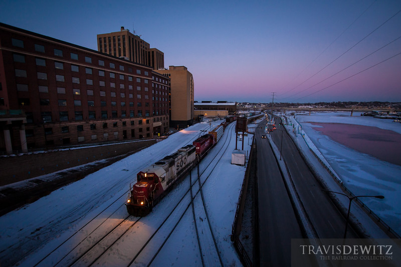 One of my favorites, a Soo Line SD60 roll west out of Pigs Eye Yard along the Mississippi River on one of the coldest days of the year. The sun has set causing the temperature to drop even further below zero as the windows downtown St. Paul reflect the last of the light of the day.