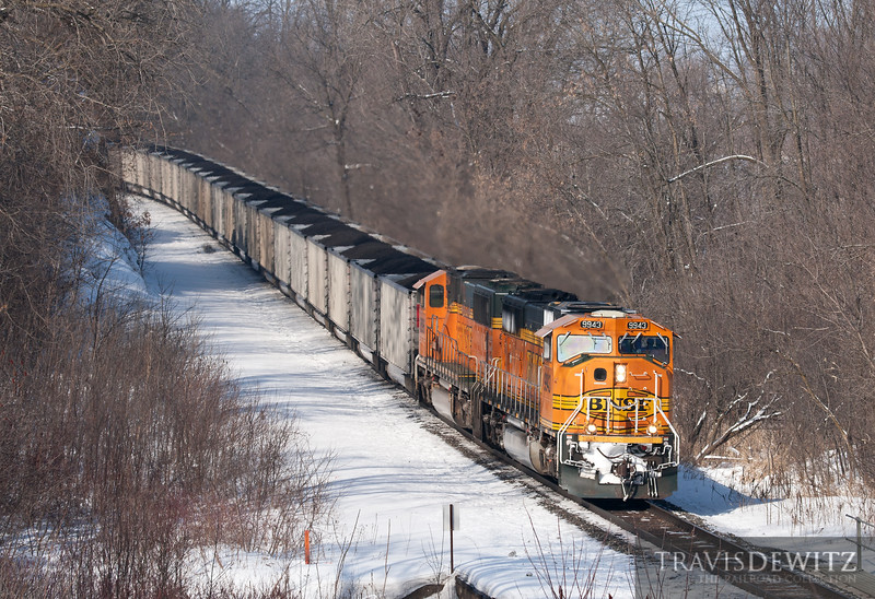 """Coal for the Columbia Power Station travels south of Winona, MN along the banks of the Mississippi River on a cold and frosty day.  Travis Dewitz <a href=""""http://www.therailroadcollection.com/latest-works/"""" target=""""_blank"""">The Railroad Collection</a>"""