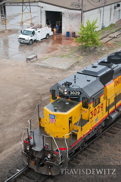 """A set of Union Pacific SD40-2s do some switching at their Saint Paul Belt Yard near Dayton's Bluff while a Cemstone worker cuts some steel in the background.  Travis Dewitz <a href=""""http://www.therailroadcollection.com/latest-works/"""" target=""""_blank"""">The Railroad Collection</a>"""