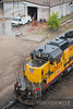 "A set of Union Pacific SD40-2s do some switching at their Saint Paul Belt Yard near Dayton's Bluff while a Cemstone worker cuts some steel in the background.  Travis Dewitz <a href=""http://www.therailroadcollection.com/latest-works/"" target=""_blank"">The Railroad Collection</a>"