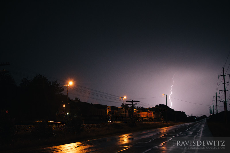 Lightning continues to strike as crews shuffle power around to get their train down the tracks.