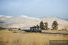The Montana Rail Link gas train heads east along golden fields near Dixon on their way to Missoula, Montana.