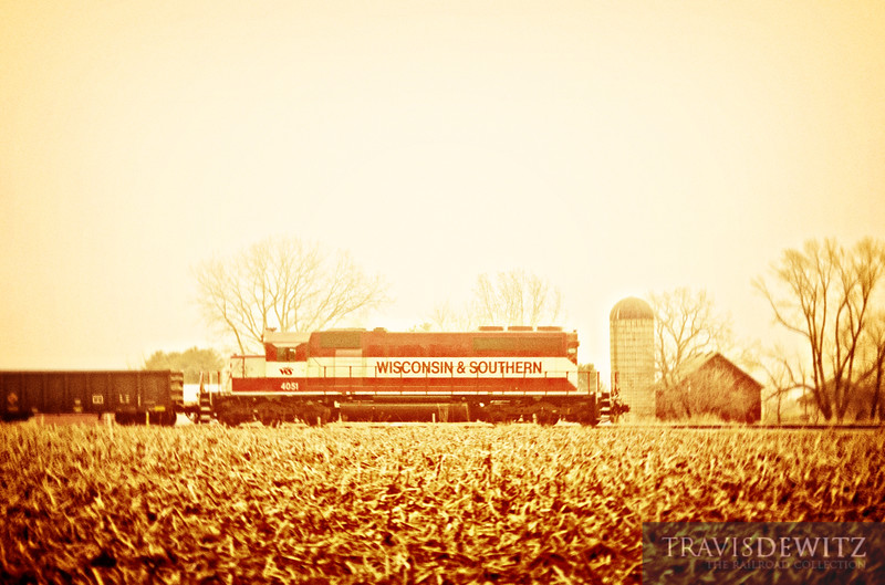 "A lone Wisconsin & Southern SD40-2 leads long hood forward across farmland just east of Zenda; Wisconsin.  Travis Dewitz <a href=""http://www.therailroadcollection.com/latest-works/"" target=""_blank"">The Railroad Collection</a>"