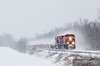 """Canadian Pacific 9704 leads empty well cars up the River Sub  through a snow storm just north of Minnesota City.  Travis Dewitz <a href=""""http://www.therailroadcollection.com/latest-works/"""" target=""""_blank"""">The Railroad Collection</a>"""