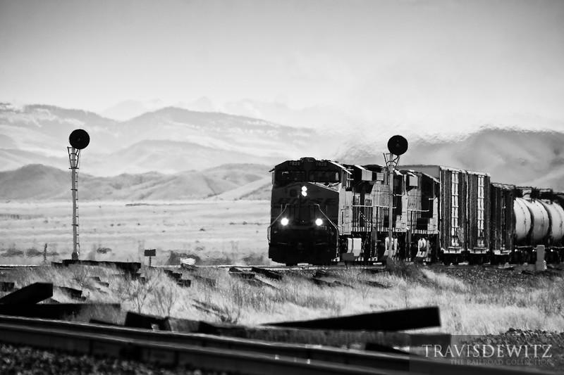 BNSF 7828 splits the signals working west upgrade towards Helena, Montana.