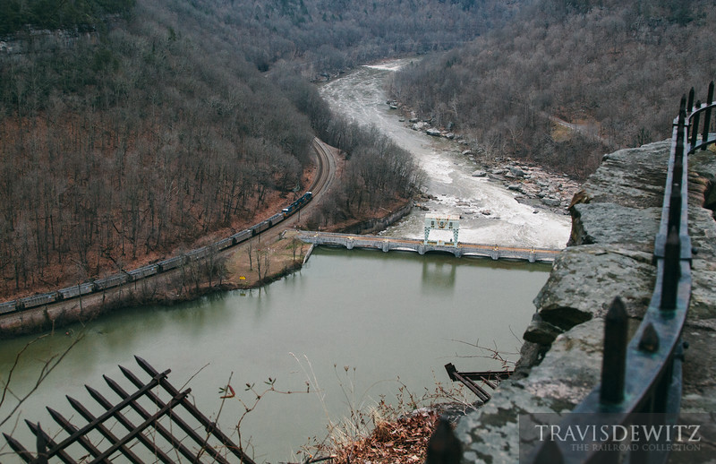 Looking down from Hawk's Nest State Park, an empty CSX coal train can be seen going past the Gauley Junction Dam.