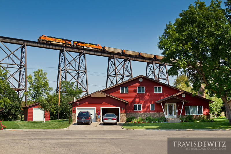 A BNSF coal train heads west over Valley City, North Dakota as home owners below barely notice.