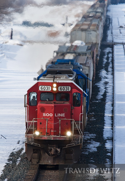 """A Soo Line SD60 led train heads down the River Sub on a cold winter day in Wabasha, Minnesota.  Travis Dewitz <a href=""""http://www.therailroadcollection.com/latest-works/"""" target=""""_blank"""">The Railroad Collection</a>"""