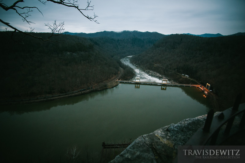 A CSX coal train snakes along the New River and past the Gauley Junction Dam.