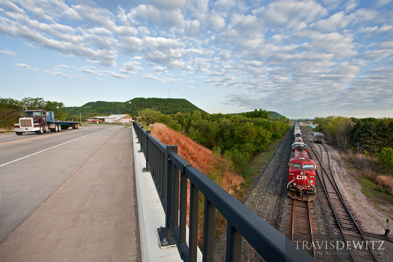 "Canadian Pacific 8536 races down river through Wabasha, MN as a semi truck crosses the tracks towards downtown.  Travis Dewitz <a href=""http://www.therailroadcollection.com/latest-works/"" target=""_blank"">The Railroad Collection</a>"