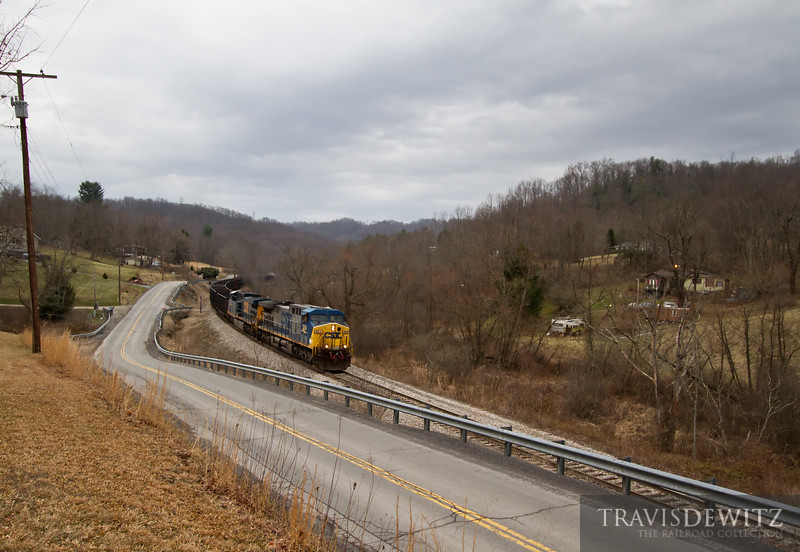 """A CSX led RJ Corman coal train is almost to Pioneer Fuel Comapny in Pax, West Virginia.  Travis Dewitz <a href=""""http://www.therailroadcollection.com/latest-works/"""" target=""""_blank"""">The Railroad Collection</a>"""