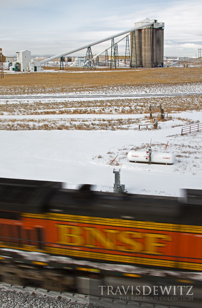 """Another BNSF coal train flies north past the Codero Mine in the Powder River Basin.  Travis Dewitz <a href=""""http://www.therailroadcollection.com/latest-works/"""" target=""""_blank"""">The Railroad Collection</a>"""