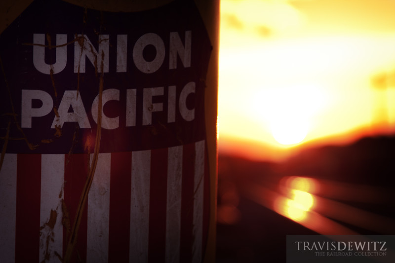 """A Union Pacific logo adorns the stack of a piece of MOW equipment that planes the top of a railroad tie for the tie plate to sit. Photo taken in Altoona, WI.  Travis Dewitz <a href=""""http://www.therailroadcollection.com/latest-works/"""" target=""""_blank"""">The Railroad Collection</a>"""