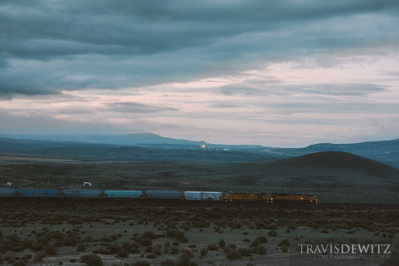 Union Pacific 8113 waits for a eastbound stack train before departing west. Rawlins, WY