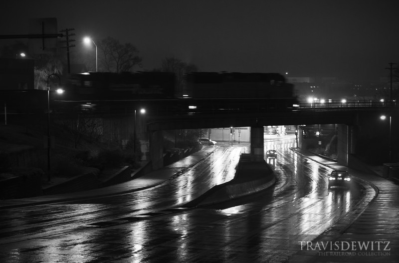 """The Union Pacific local job crosses over the Madison Street Bridge near downtown Eau Claire after leaving the Altoona yard on their way north to Chippewa Falls, Wisconsin.  Travis Dewitz <a href=""""http://www.therailroadcollection.com/latest-works/"""" target=""""_blank"""">The Railroad Collection</a>"""