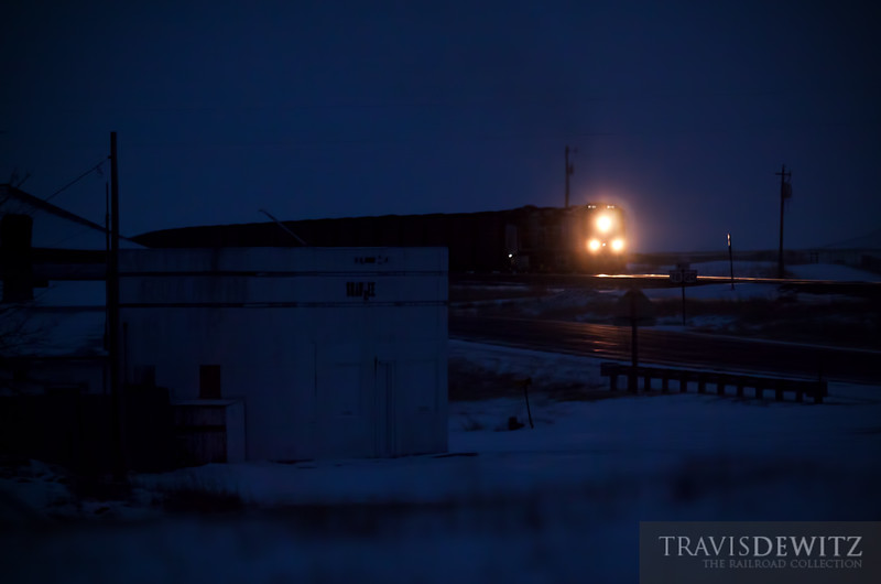 """A Union Pacific train passes an abandoned cafe in Shawnee, Wyoming well during the blue hour. These hoppers full of coal are headed east out of the Powder River Basin.  Travis Dewitz <a href=""""http://www.therailroadcollection.com/latest-works/"""" target=""""_blank"""">The Railroad Collection</a>"""