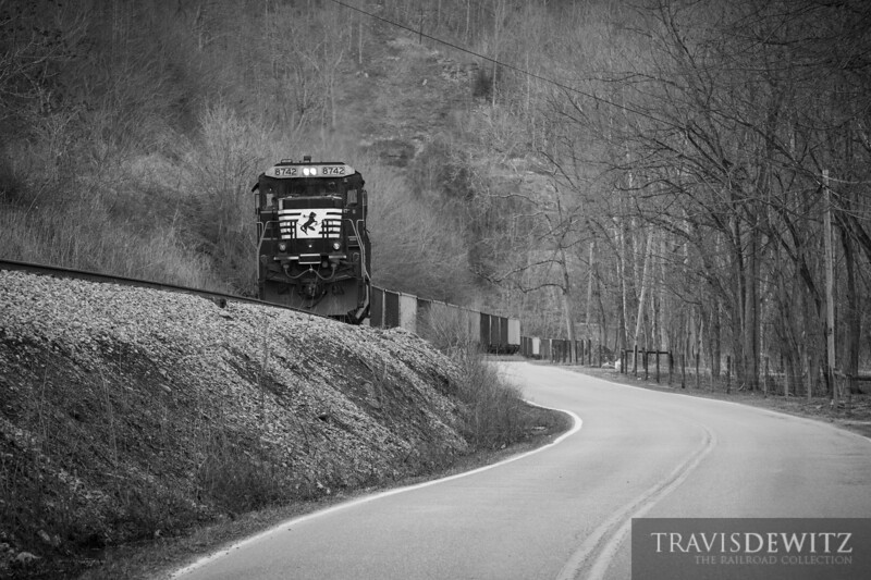 Norfolk Southern 8742 shoves empty coal hoppers back to the Lobata Coal Mine just east of Williamson, West Virginia.