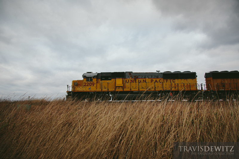 Union Pacific SD60 grabs a string of sand cars and hauls them back to the yard in Altoona. Seen here heading west near Fall Creek, Wisconsin.