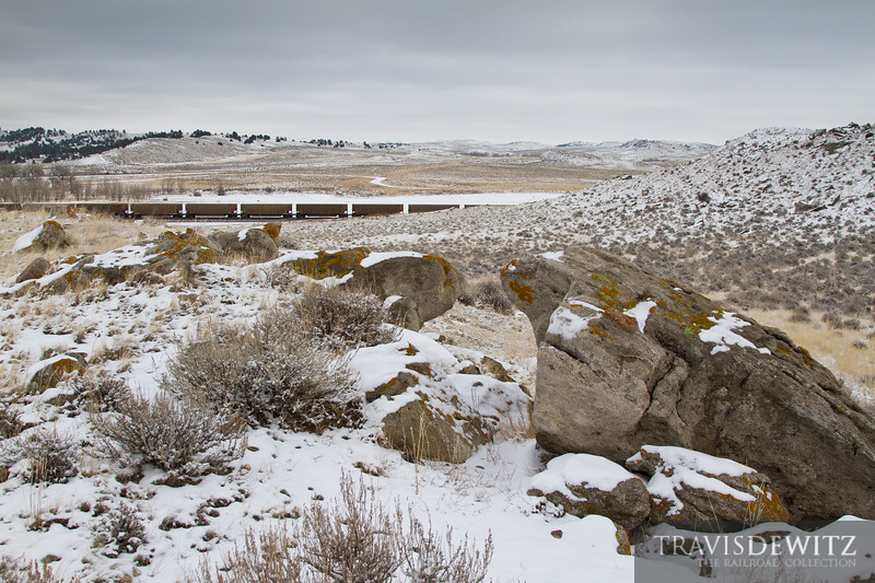 Endless strings of coal hoppers glide across the winter Wyoming landscape.