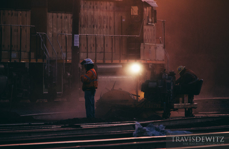 A rail gang goes to work on this cold early October morning before the sun rises. This rail crew is replacing all the stick rail in Union Pacific's Altoona, Wisconsin yard with welded rail.