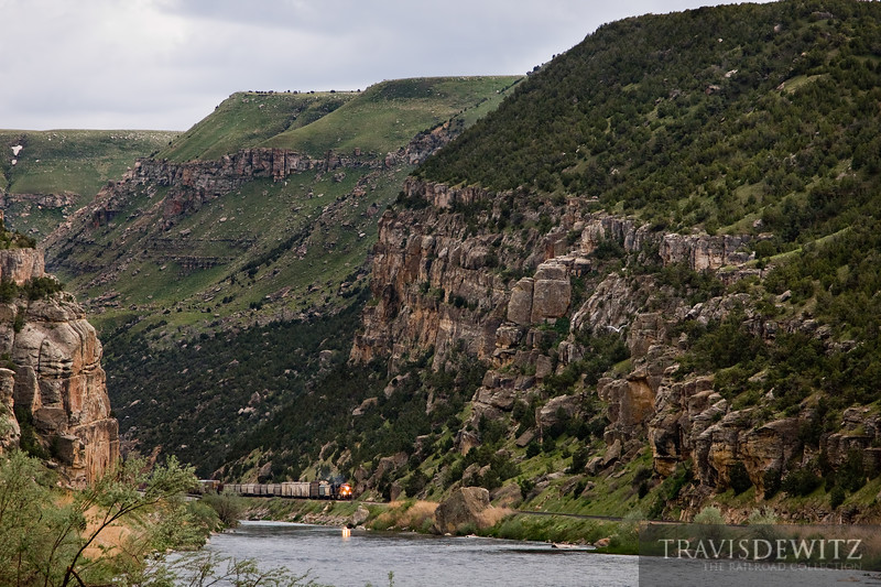 """The grand scale of the Wind River Canyon can best be seen here as it dominates over a BNSF freight train near Thermopolis, Wyoming.  Travis Dewitz <a href=""""http://www.therailroadcollection.com/latest-works/"""" target=""""_blank"""">The Railroad Collection</a>"""