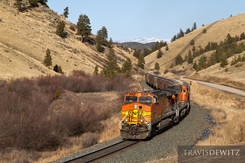 BNSF 5714 pulls its train up the east slope of Mullan Pass approaching Austin, Montana.