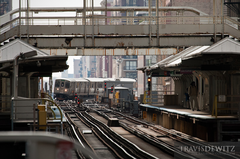 """Chicago's CTA Harlem green line """"L"""" train rounds the curve into the station.  Travis Dewitz <a href=""""http://www.therailroadcollection.com/latest-works/"""" target=""""_blank"""">The Railroad Collection</a>"""