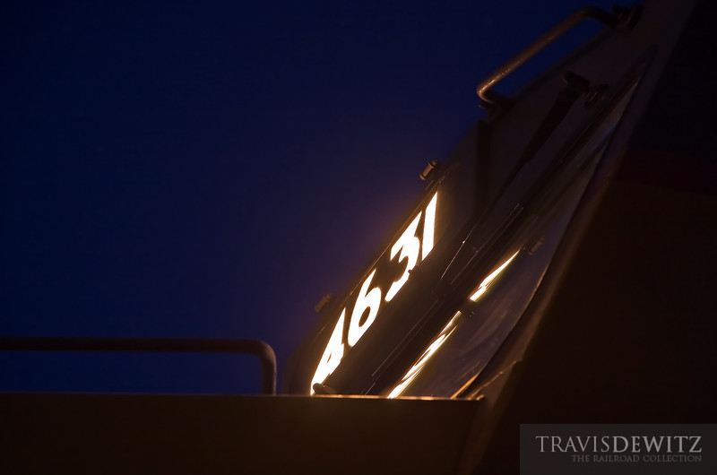 "An almost abstract view of the number boards glowing in the night from an Union Pacific SD70M.  Travis Dewitz <a href=""http://www.therailroadcollection.com/latest-works/"" target=""_blank"">The Railroad Collection</a>"