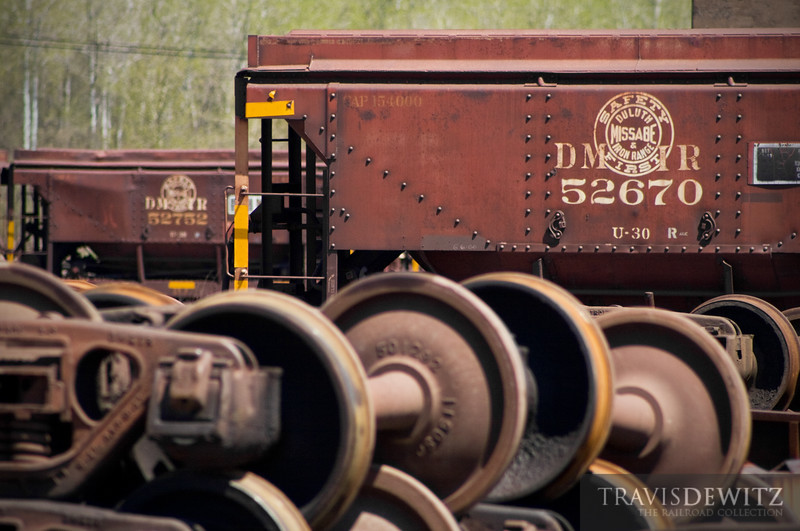 """Wheel sets are stacked in the Proctor yard along with many ore cars, some which are in for repairs and many more I am sure will be scrap.  Travis Dewitz <a href=""""http://www.therailroadcollection.com/latest-works/"""" target=""""_blank"""">The Railroad Collection</a>"""