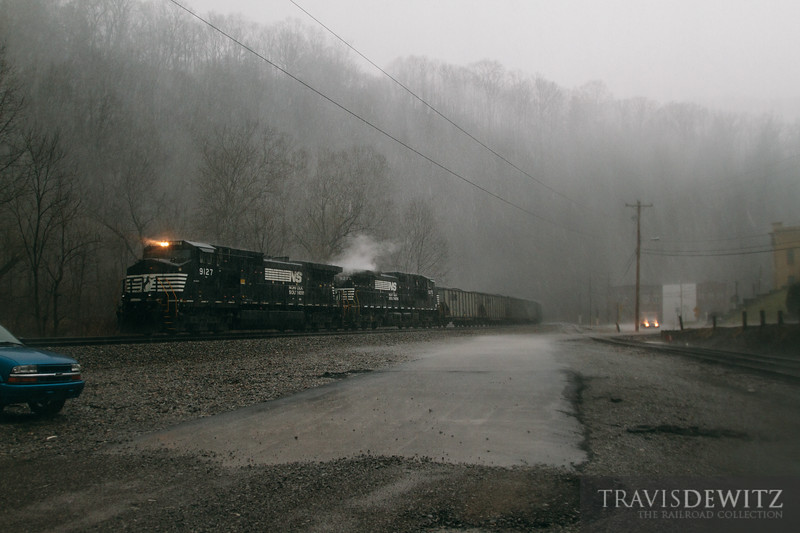A thunderstorm sweeps over southwestern West Virginia and unleashes a downpour of rain as seen here in Kimball as a Norfolk Southern coal train gets drenched.