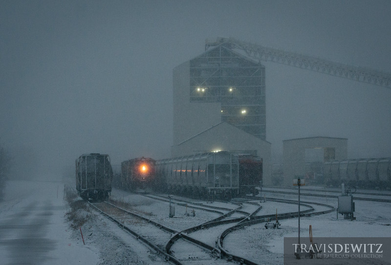 An empty sand train has just arrived from the Union Pacific at Chippewa Falls, Wisconsin. A snowstorm is just starting to impact the area. You can also see the incomplete frac sand loading facility.