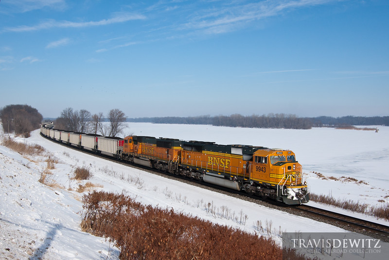 """BNSF led Columbia Power Plant coal train heads down the Mississippi River on Canadian Pacific's River Subdivision at Dakota, MN.  Travis Dewitz <a href=""""http://www.therailroadcollection.com/latest-works/"""" target=""""_blank"""">The Railroad Collection</a>"""