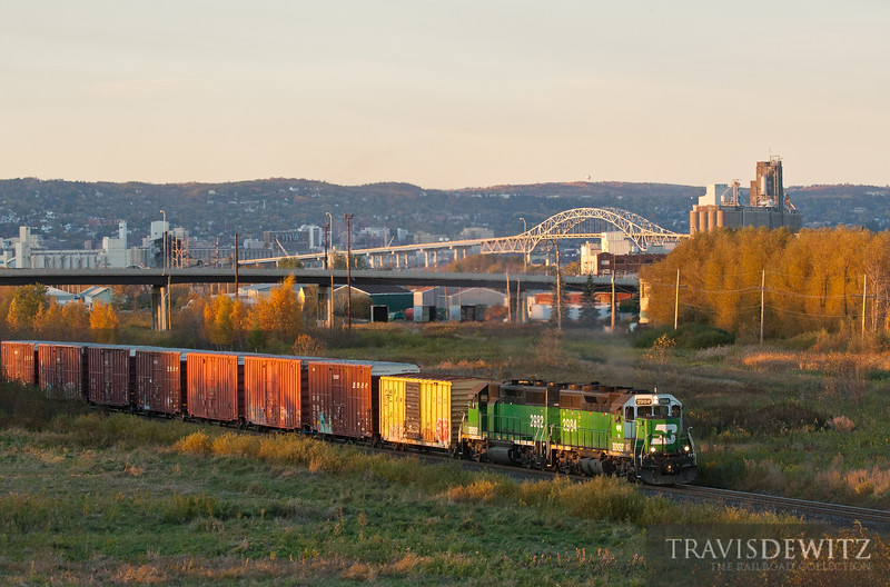 """BNSF 2984 and 2982 make their way back to the 28th Street Yard in Superior, WI with the Duluth skyline as a back drop.  Travis Dewitz <a href=""""http://www.therailroadcollection.com/latest-works/"""" target=""""_blank"""">The Railroad Collection</a>"""