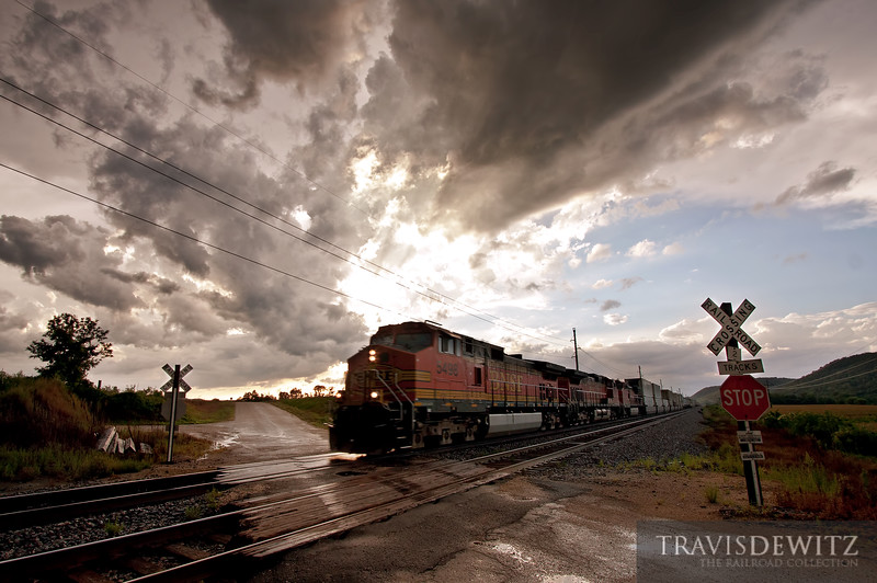 """A BNSF Z train races down the St. Croix Sub just south of Alma, Wisconsin as a thunderstorm disapates overhead.  Travis Dewitz <a href=""""http://www.therailroadcollection.com/latest-works/"""" target=""""_blank"""">The Railroad Collection</a>"""