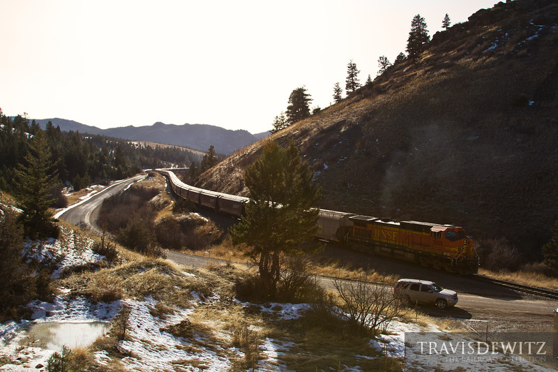 BNSF DPU 5605 pushes hard to get its train up Mullan Pass to keep heading west to Missoula.
